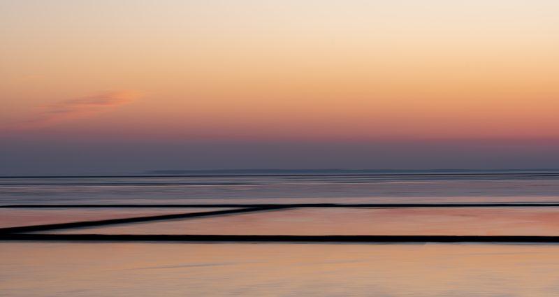Sonnenuntergang am Deich bei Ockholm